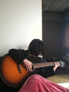 Aya, enjoying a soft guitar and a warm kotatsu.